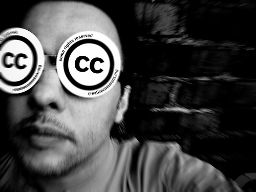 man wearing glasses with CC written on them