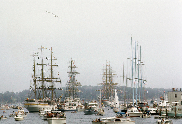 Tall ships and smaller boats.
